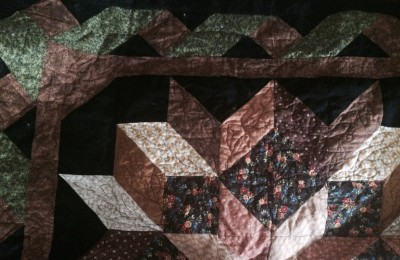 Using recycled materials, like shirts, to make a quilt can make a beautiful gift.