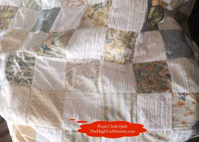 Quilt made with scraps of old terry wash cloths, blankets, and fabric pieces from old clothing.