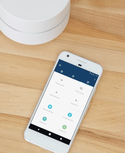 Google Wi-Fi device with a screenshot of the accompanying app.