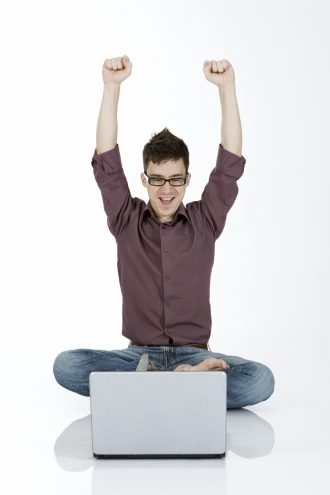 happy guy on computer laptop