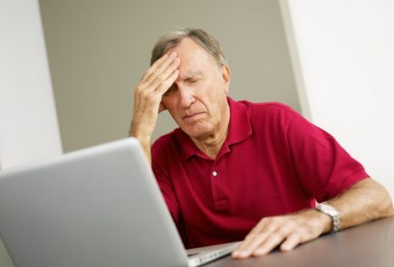 confused senior man on computer